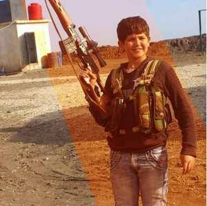 Ein kurdischer Junge mit einer Druganov